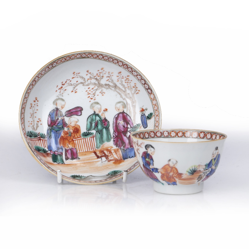 Matched teabowl and saucer Chinese, 18th Century decorated with three women and a child in a garden,