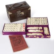 Bone and bamboo mahjong set Chinese in a leather case, 19cm wide Condition: worn and scratched and