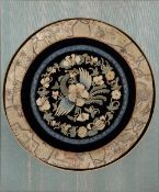 Kesi roundel embroidered silk depicting a phoenix amongst flowers worked in coloured silk threads,