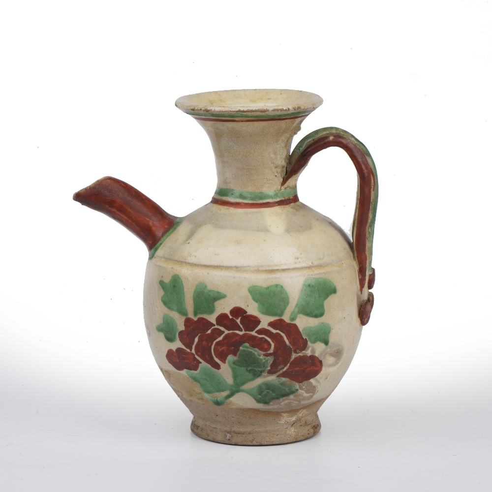 White glazed ewer Chinese, Tang dynasty painted with a flowering plant to the body of the vase,