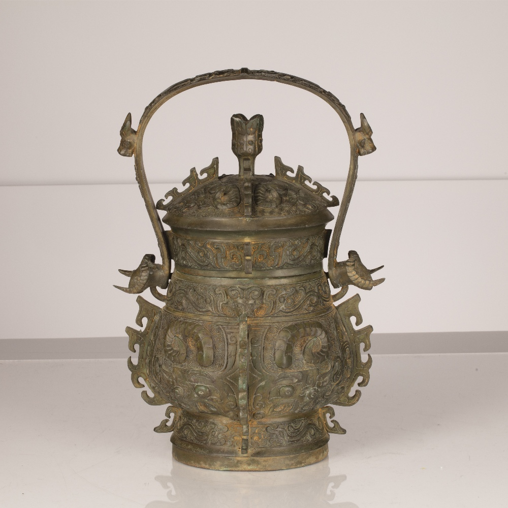 Bronze Shang dynasty style vessel (you) Chinese with loop handle and cover, 33cm high Ex Desmond - Image 2 of 4