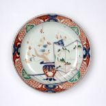 Imari decorated dish Japanese, late 18th Century decorated with an ikebana arrangement within a