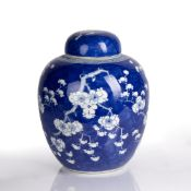 Blue and white ginger jar and cover Chinese decorated to the body with prunus leaf decoration,