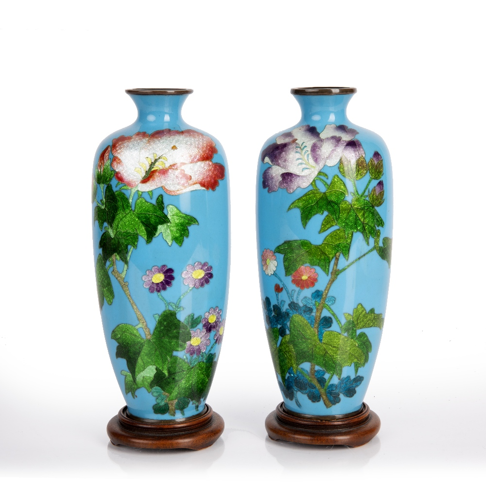 Pair of Ginbari enamel vases Japanese, Meiji period each of blue ground decorated with flowers,