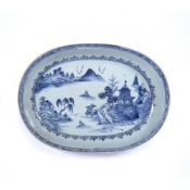 Oval blue and white dish Chinese, circa 1800 decorated to the centre with a river landscape with
