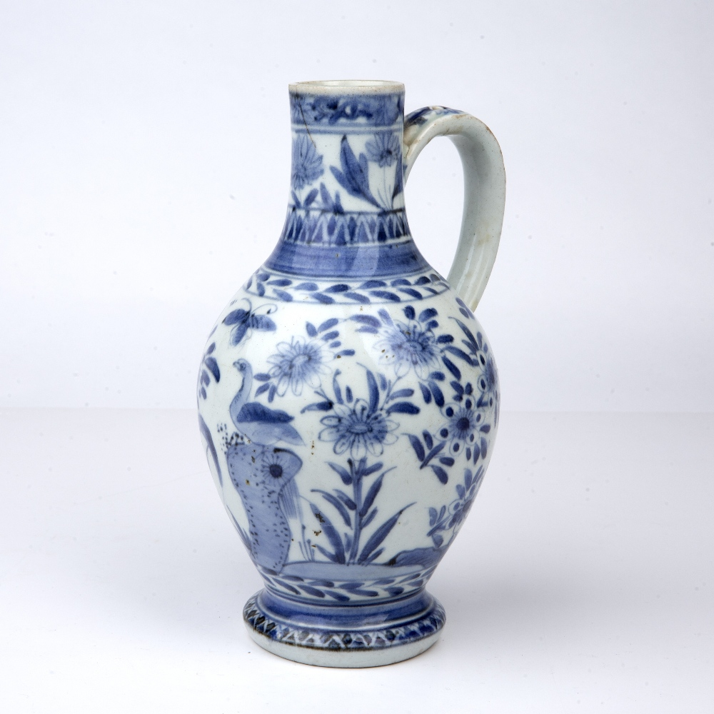 Blue and white ewer Japanese, 18th Century decorated with birds and butterflies perched on - Image 2 of 5