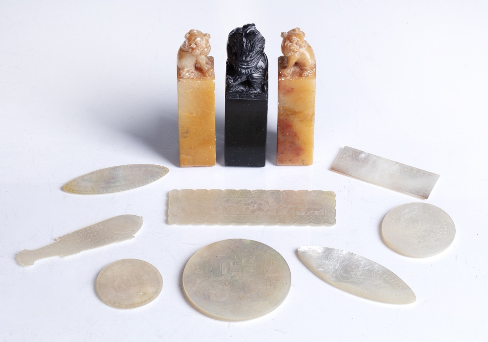 Three soapstone seals Chinese each with a temple dog finial and eight mother of pearl engraved