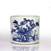 Blue and white brush pot Chinese decorated to the exterior with peacocks sat on a tree, 15.5cm