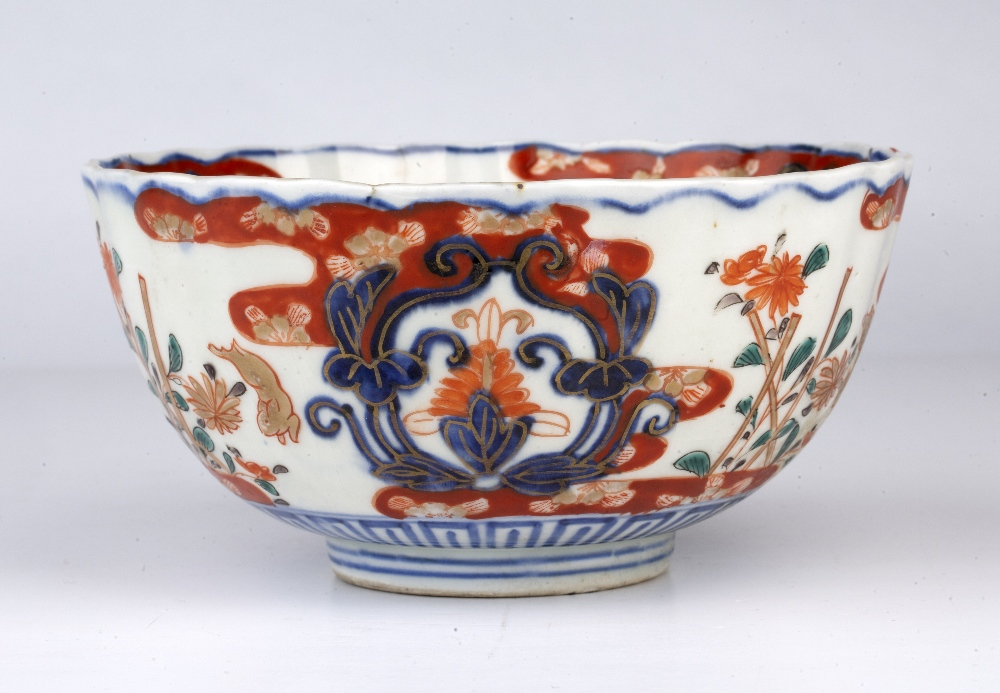 Imari bowl Japanese, 19th Century decorated with leaping rabbits beside stacked flowers divided by - Image 2 of 5