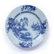 Blue and white charger Chinese, 18th Century decorated to the centre with a river landscape