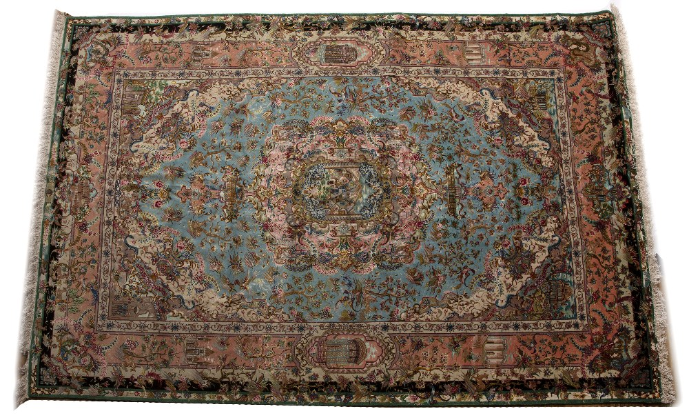 Silk prayer rug Persian of blue and pink ground with buildings, birds and figures, 280cm x 178cm
