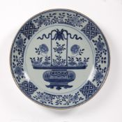 Blue and white charger Chinese, circa 1800 the centre depicting a bronze object containing flowering