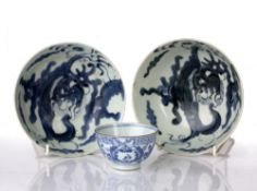 Pair of blue and white provincial bowls Chinese, circa 1800 decorated with dragons to the centre,