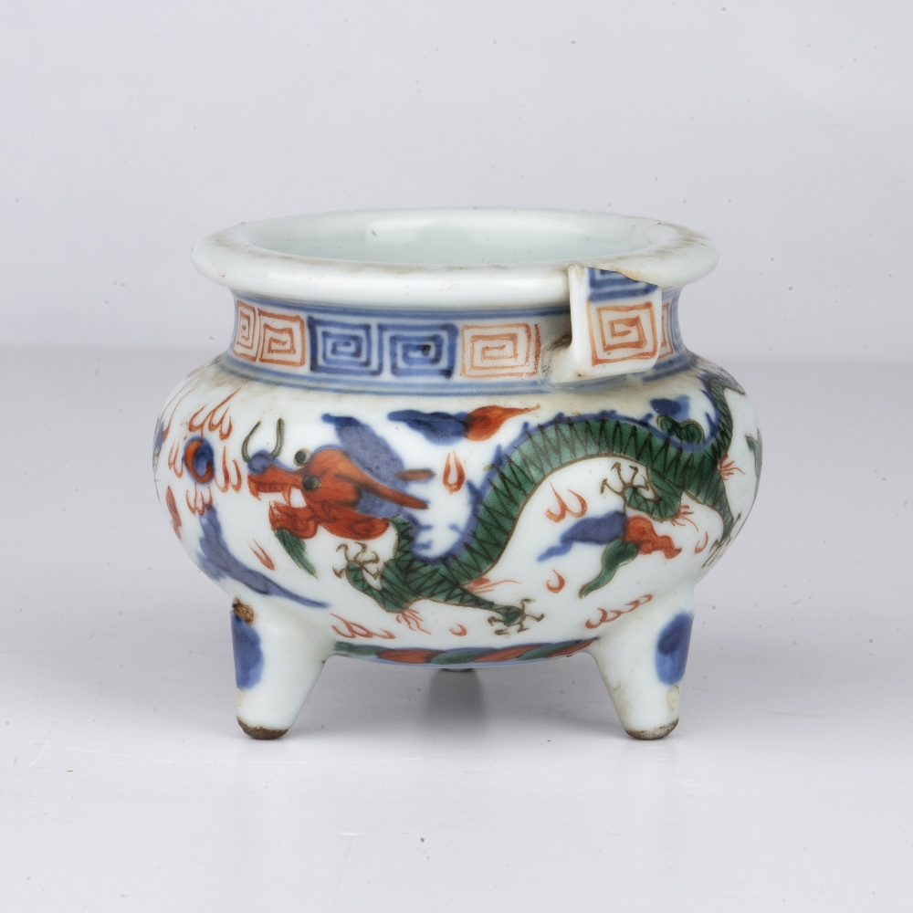 Wucai tripod censer Chinese, 19th Century decorated around the sides with dragons chasing the