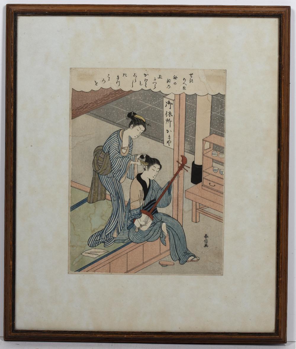 Suzuki Harunobu (1724-1770) 'Combing his hair' woodcut in colours, 28.5cm x 21.5cm Condition: some