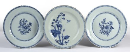 Three blue and white plates Chinese, 18th/19th Century comprising of a pair depicting a central