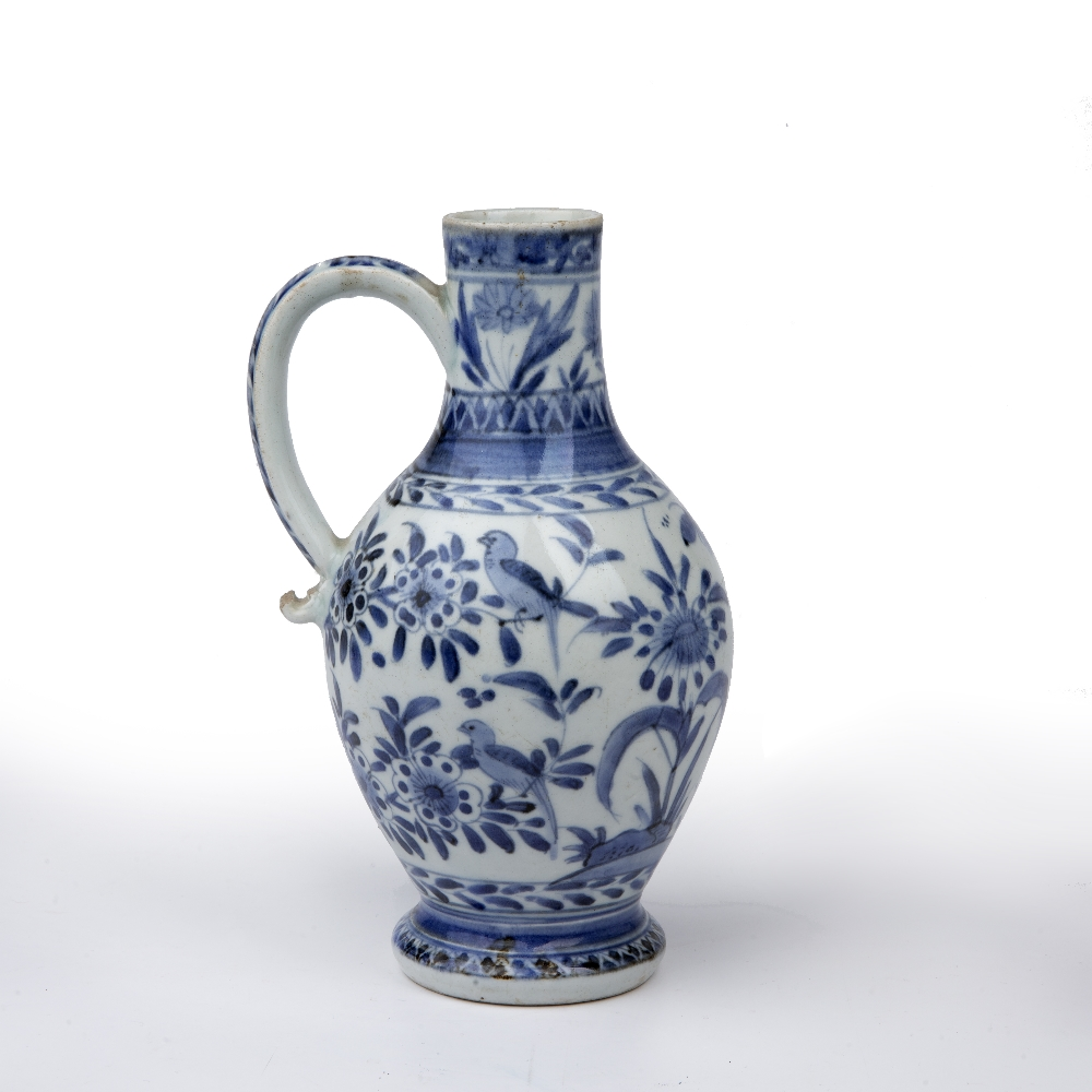 Blue and white ewer Japanese, 18th Century decorated with birds and butterflies perched on