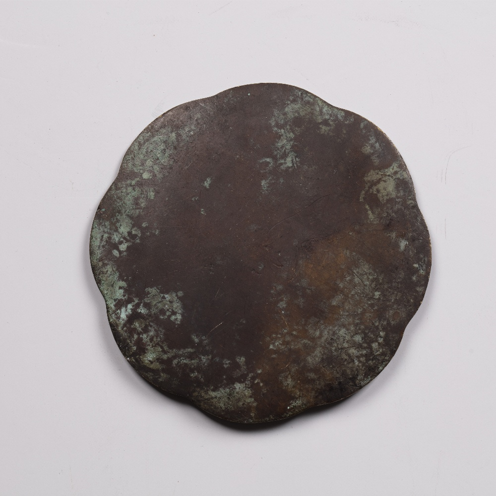 Bronze mirror Tang Dynasty of eight lobes, cast with dragon and cloud scrolls, 12.5cm diameter - Image 2 of 2