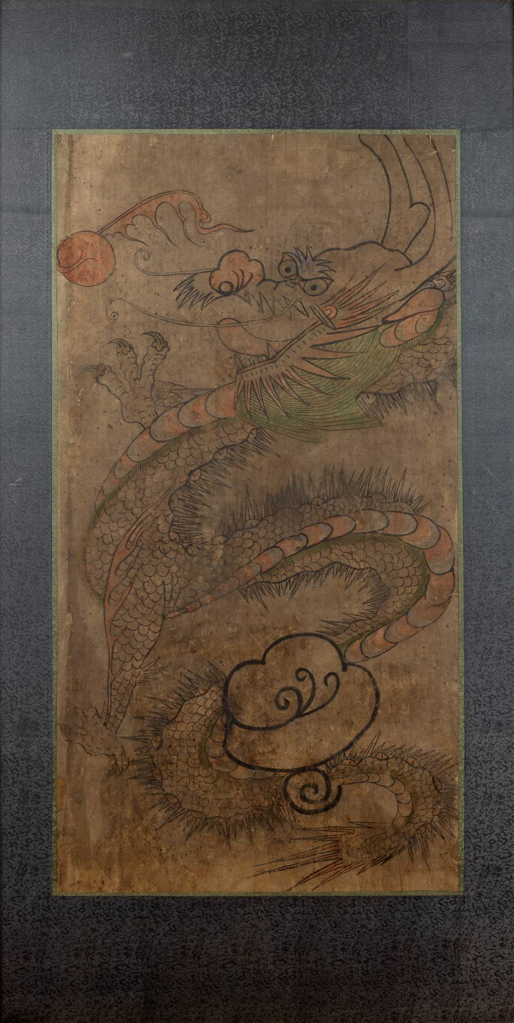 Framed scroll of a dragon Chinese depicted in flight amongst clouds chasing a flaming pearl, 87cm