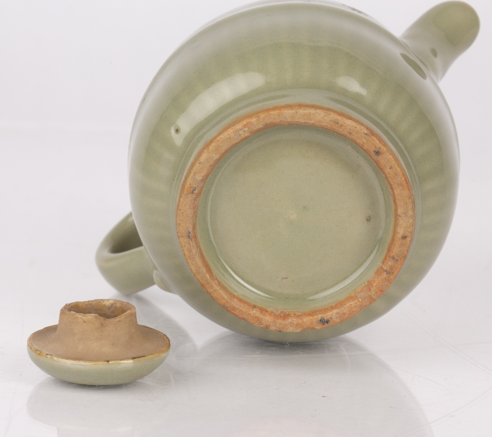 Celadon lidded teapot Chinese, Yuan / Ming dynasty with a lobed rim, 9.5cm high Condition: lid has a - Image 4 of 4
