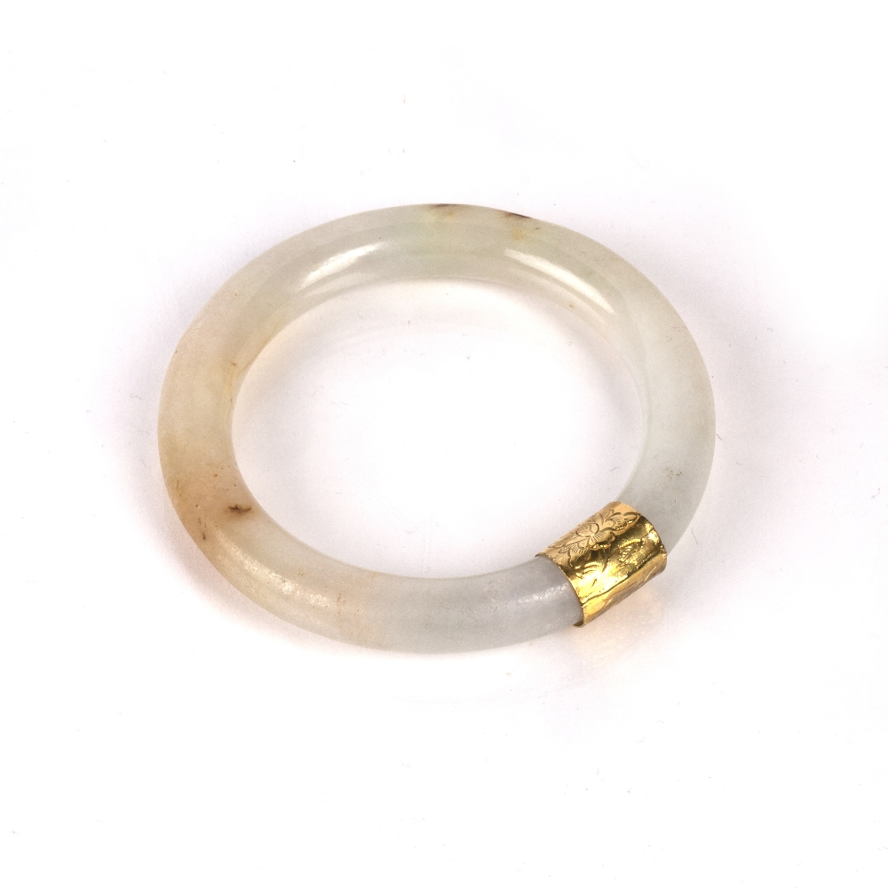 Jadeite bangle Burmese with a yellow metal mount, 7.5cm across Condition: general wear, (untested - Image 2 of 2