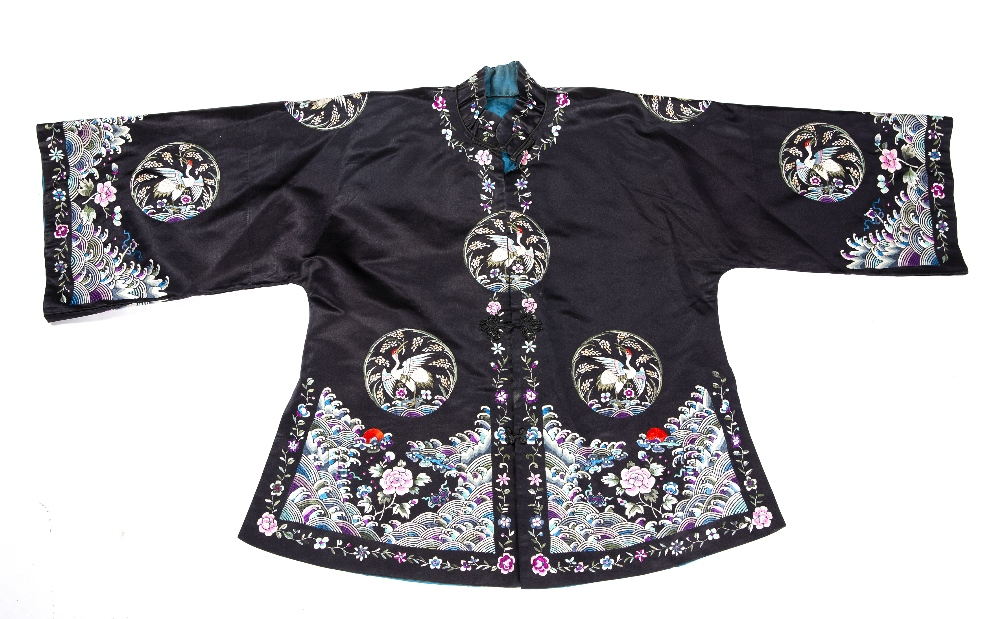 Two embroidered jackets Chinese, 20th Century decorated to the exterior with crashing waves near the