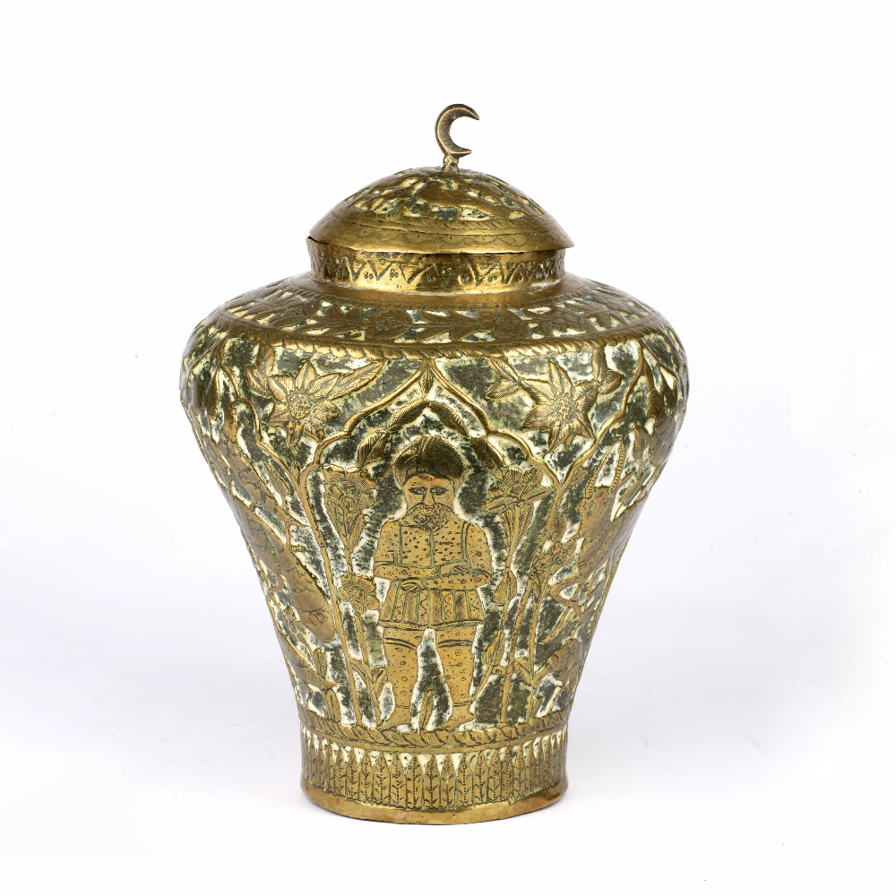 Qajar brass pot and cover Iran embossed with figures and animals and crescent finial, 30cm high