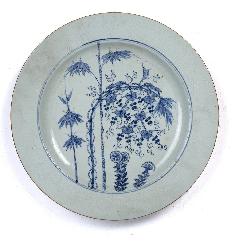 Blue and white porcelain charger Chinese, Qianlong period painted with bamboo and flowers within a