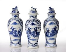 Three blue and white lidded vases Chinese, 19th Century decorated to the body with panels of