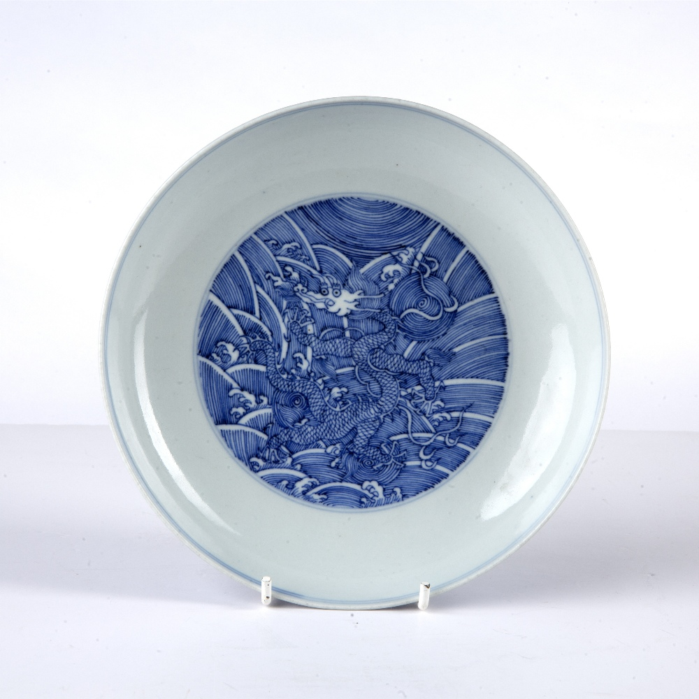Blue and white plate Chinese decorated to the interior with a roundel depicting a five clawed dragon