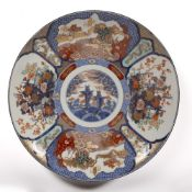 Large Arita polychrome charger Japanese, late 19th Century with a circular roundel decorated with
