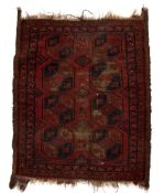 Bokhara red ground rug with eight elephant foot medallions, 107cm x 88cm Condition: worn and losses