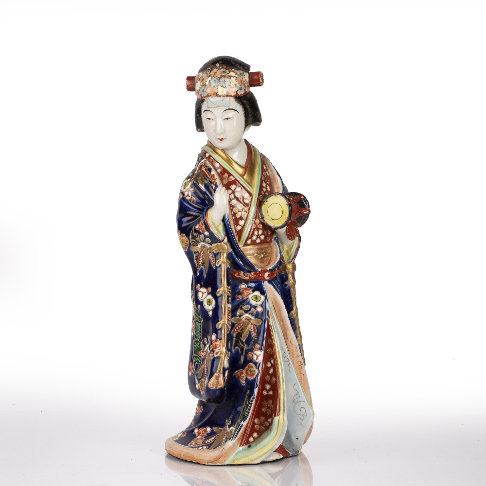 Standing Arita model geisha Japanese, late 19th Century the traditionally robed figure holding a