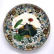 Ao-kutani charger Japanese, circa 1800 boldly decorated with a rock perched upon a lotus plant