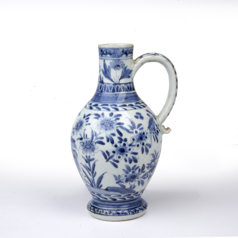 Blue and white ewer Japanese, 18th Century decorated with birds and butterflies perched on - Image 3 of 5