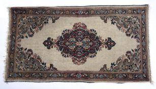 Miniature Bijar rug North West Persia of ivory ground, with foliate medallion, 117cm x 63cm