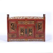 Wood and red lacquer altar cabinet Chinese with carved drawers and cupboards, 65cm x 47cm
