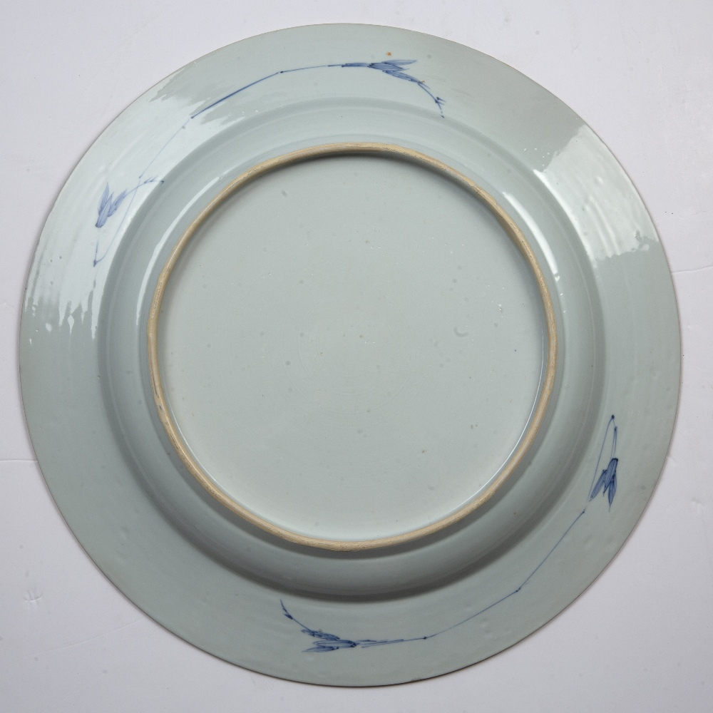 Blue and white porcelain charger Chinese, Qianlong period painted with bamboo and flowers within a - Image 2 of 2