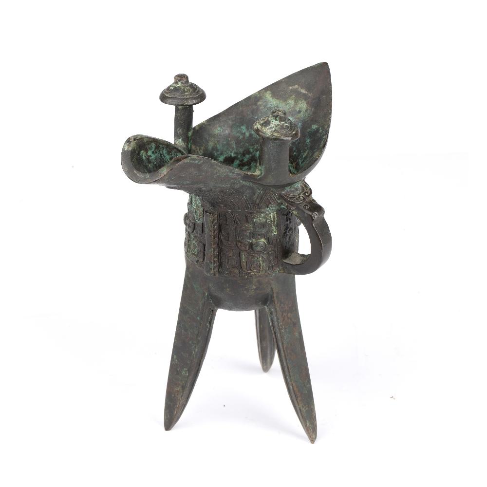Bronze ritual tripod wine vessel, Jue Chinese, 18th/19th Century raised on three curved blade