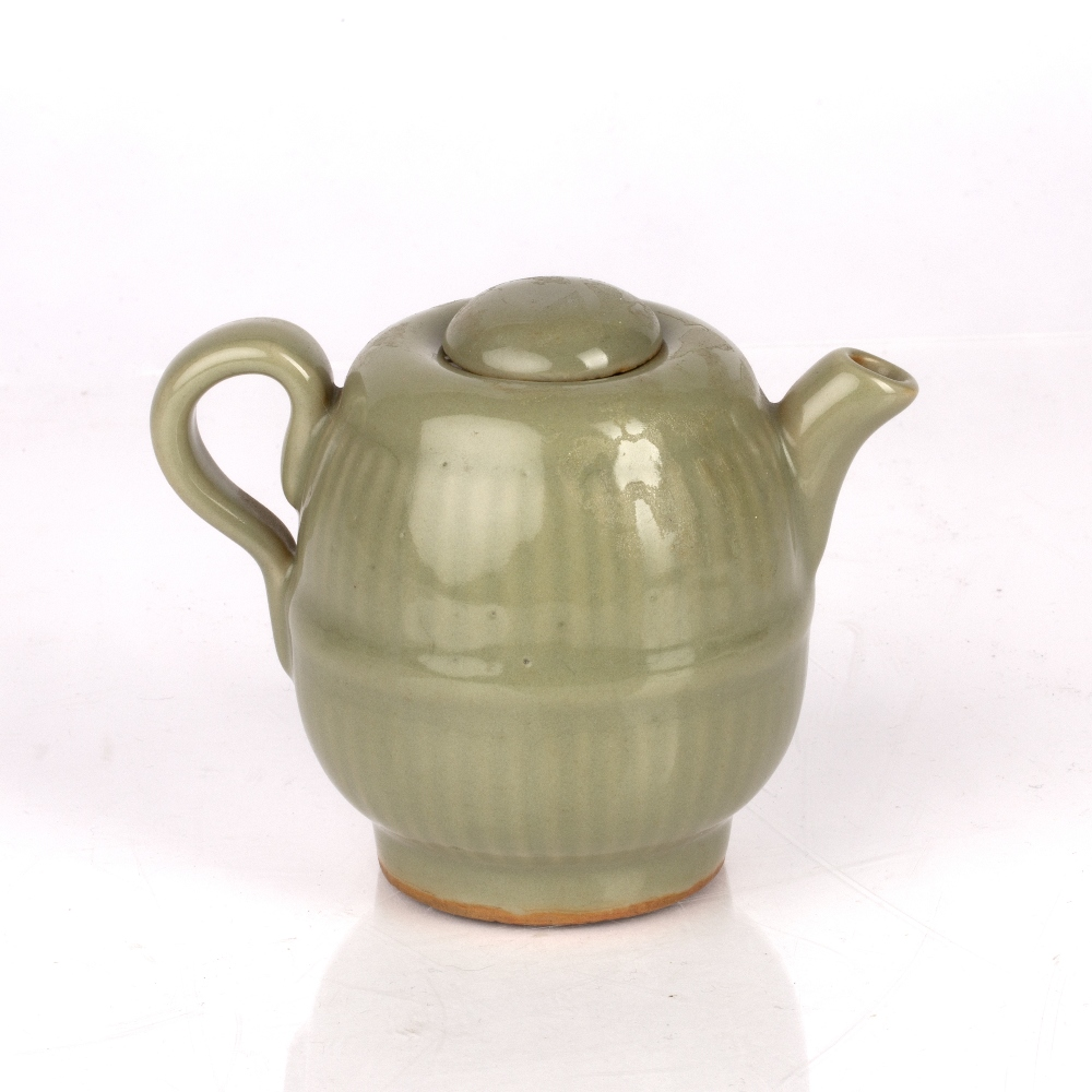 Celadon lidded teapot Chinese, Yuan / Ming dynasty with a lobed rim, 9.5cm high Condition: lid has a - Image 2 of 4