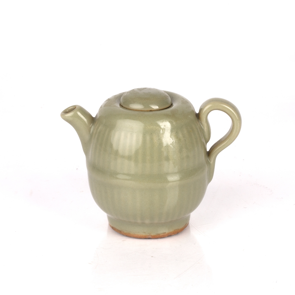 Celadon lidded teapot Chinese, Yuan / Ming dynasty with a lobed rim, 9.5cm high Condition: lid has a