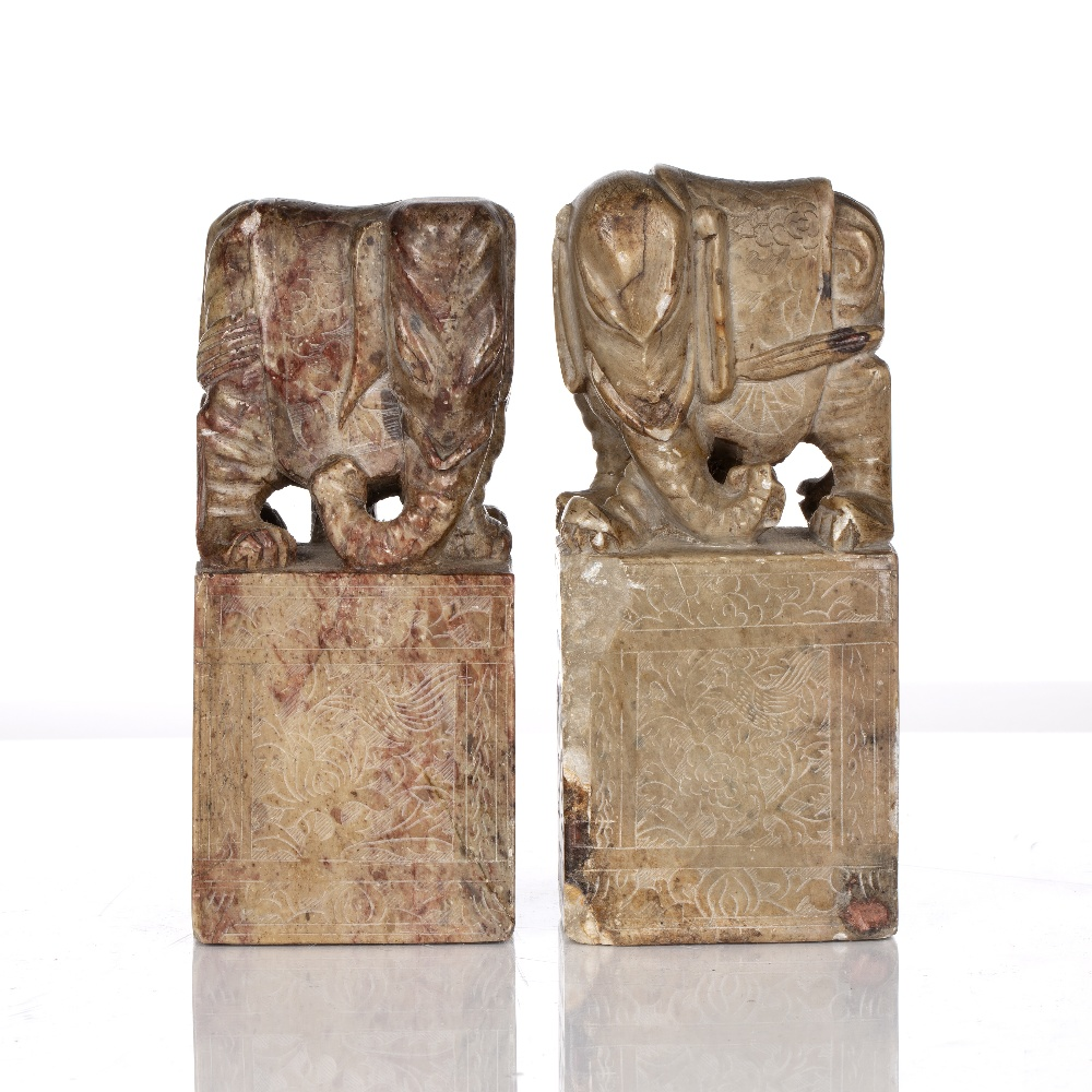 Pair of soapstone seals Chinese, 19th Century each with elephant mounts and having engraved sides,