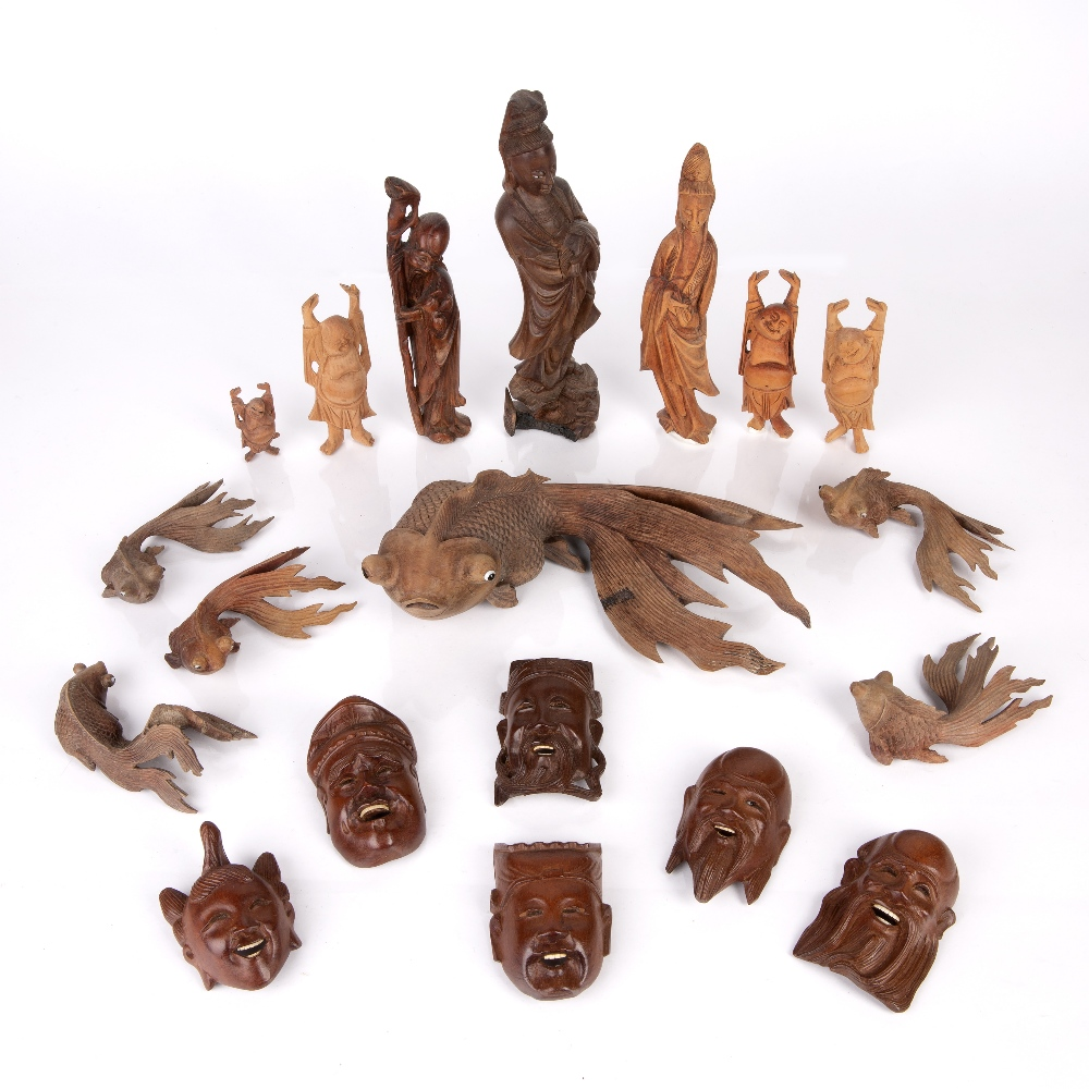 Group of carved wood pieces Chinese and South East Asian including various model fish, Guanyin and