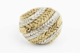 An 18ct two colour gold dress ring, of plaited and woven design, with London import marks, ring size
