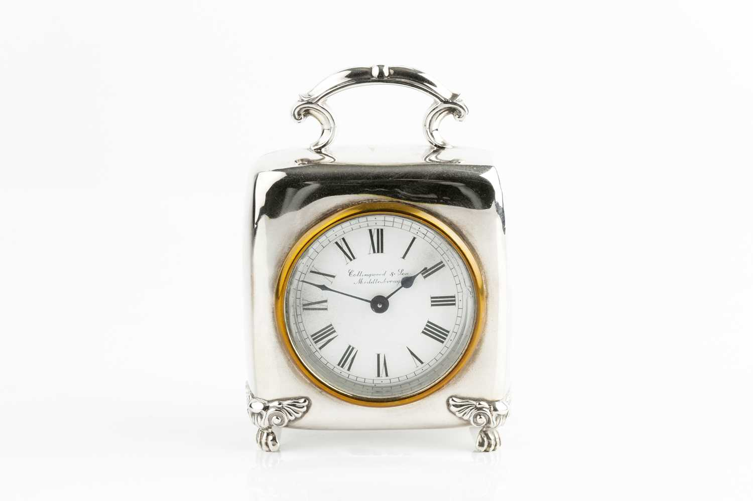 An Edwardian silver cased mantel timepiece, of rounded square design, with scroll handle, and - Image 2 of 3