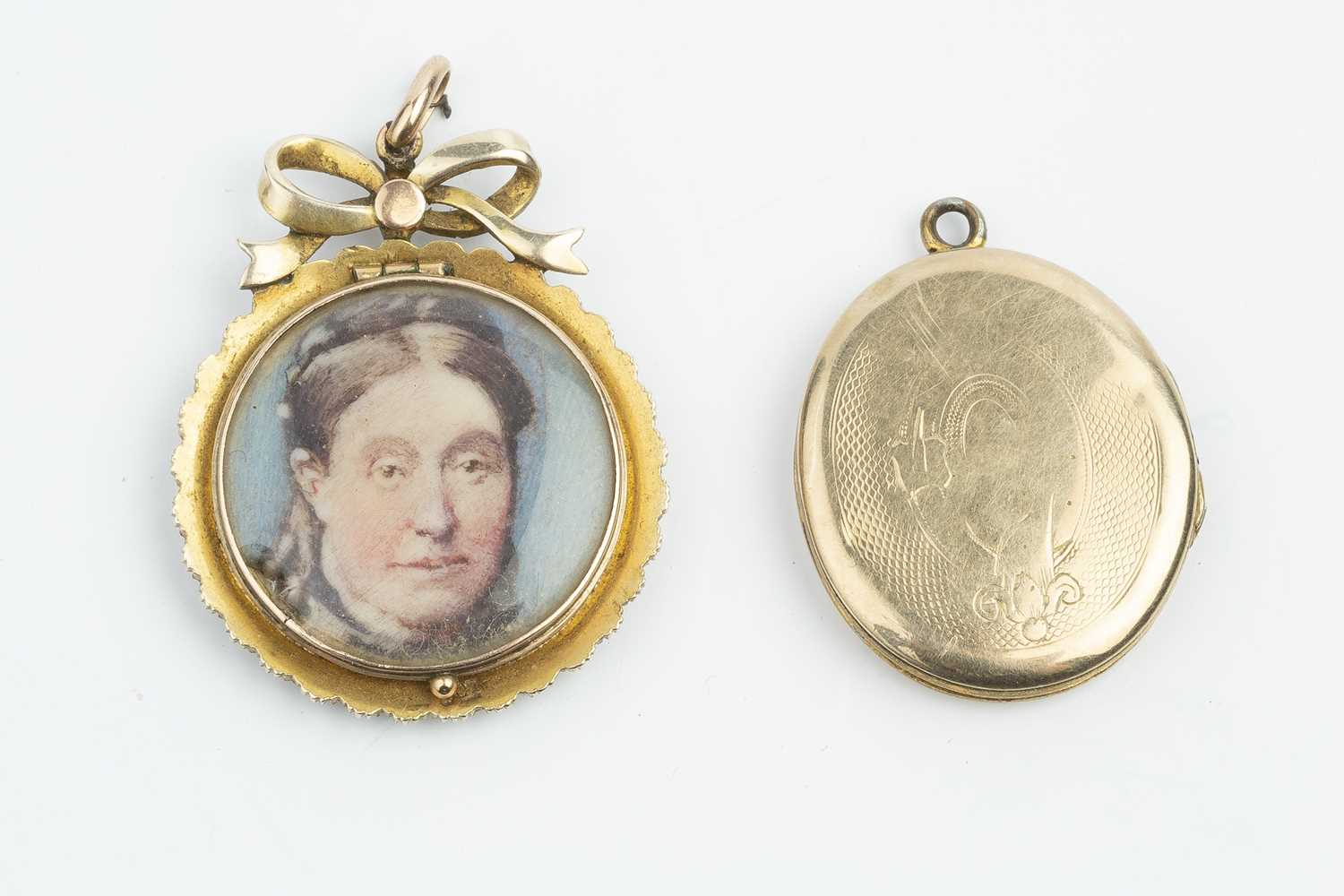 A late Victorian half pearl locket pendant, the dual-sided glazed locket containing two portrait - Image 2 of 2