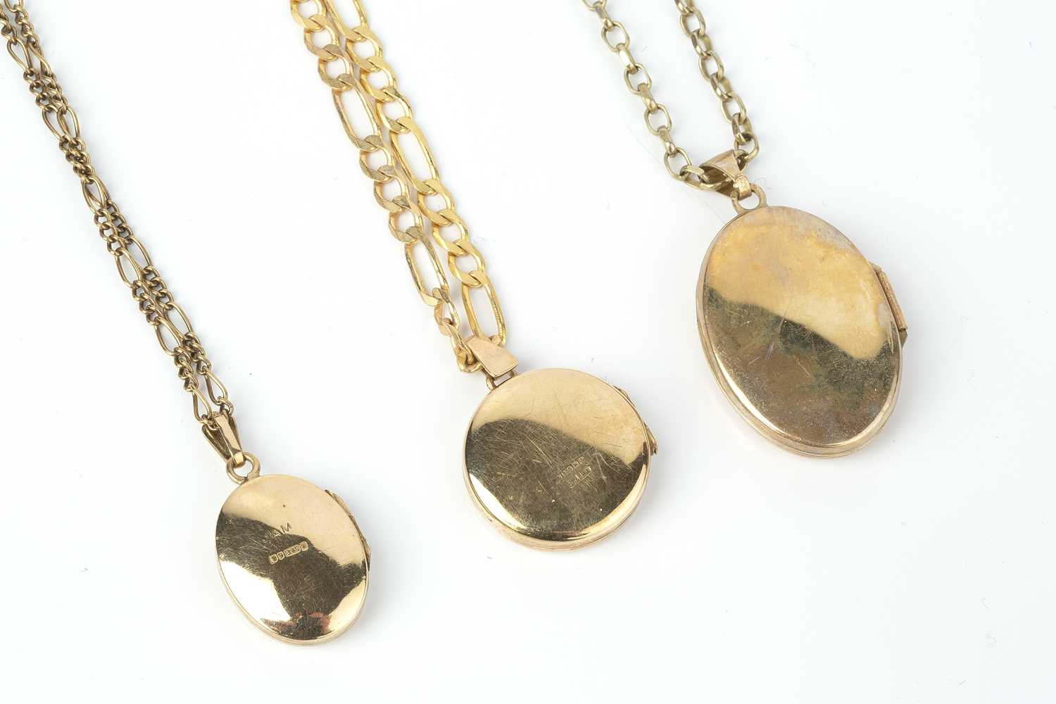 Three locket pendants on chains, comprising a 9ct gold circular locket pendant, with engraved - Image 2 of 2
