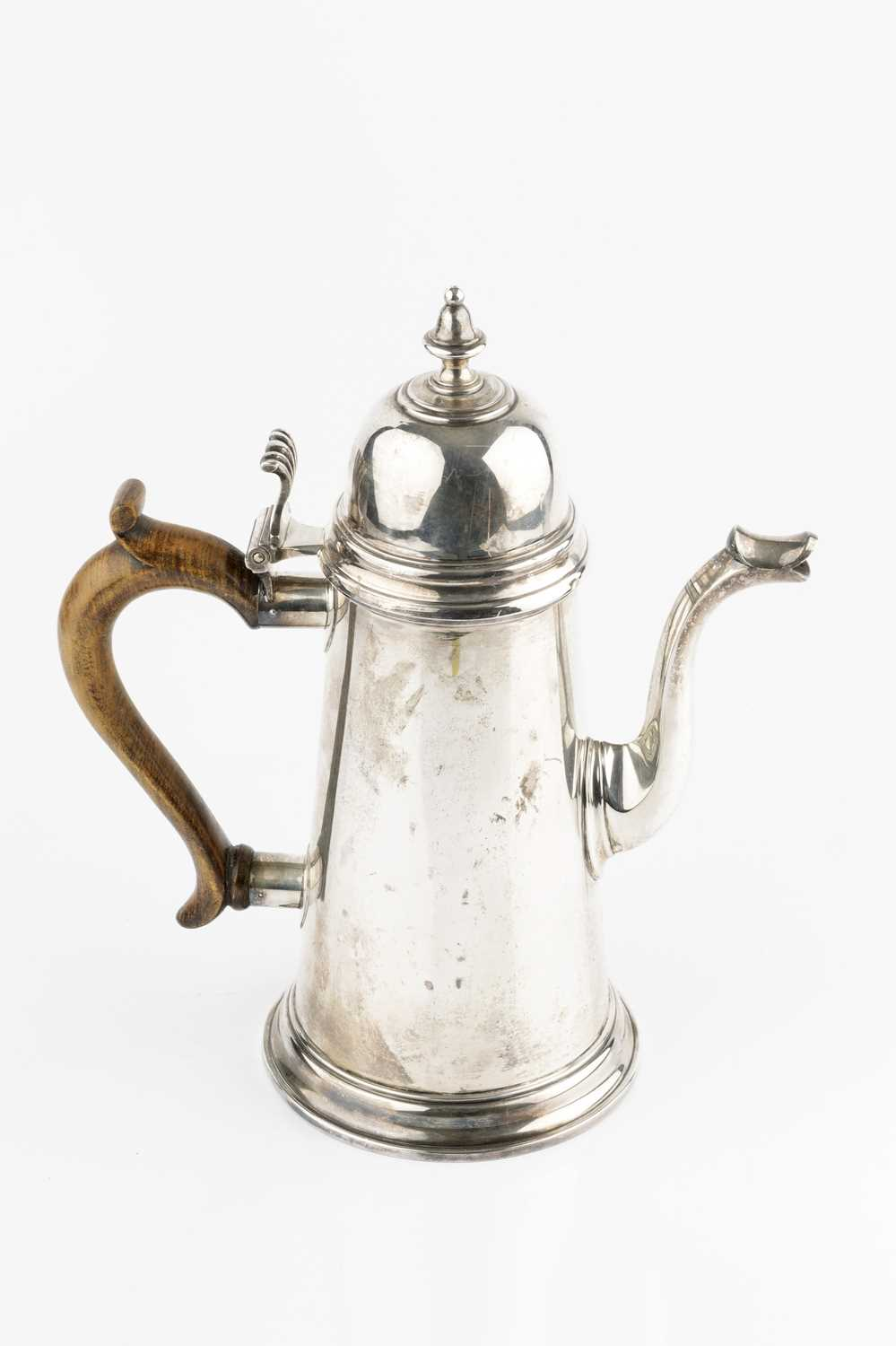A silver coffee pot, of tapered form, with hinged domed cover, and wooden handle, by Wakely &
