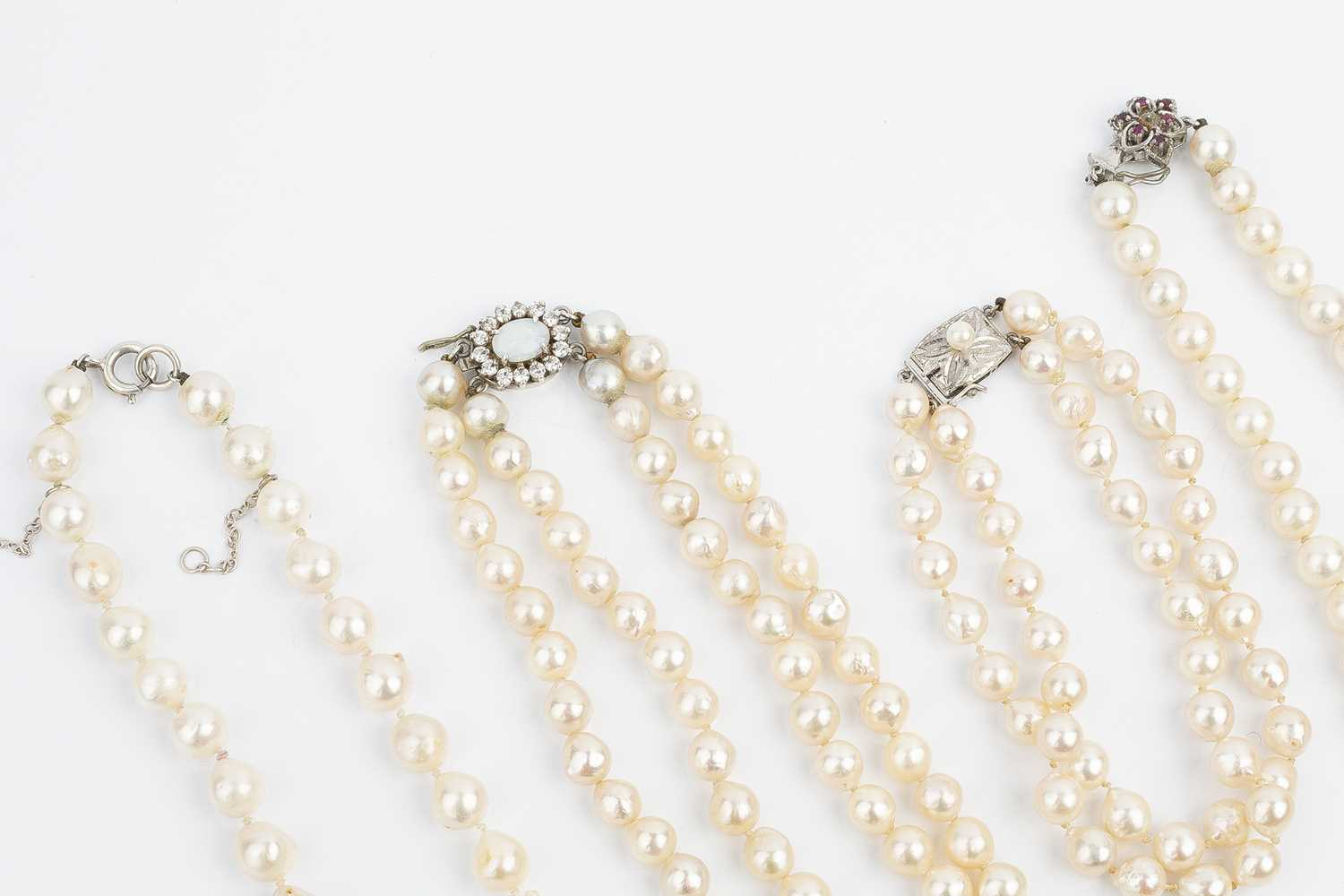 A collection of cultured pearl jewellery, comprising a double strand collar necklace, with an oval - Image 2 of 2