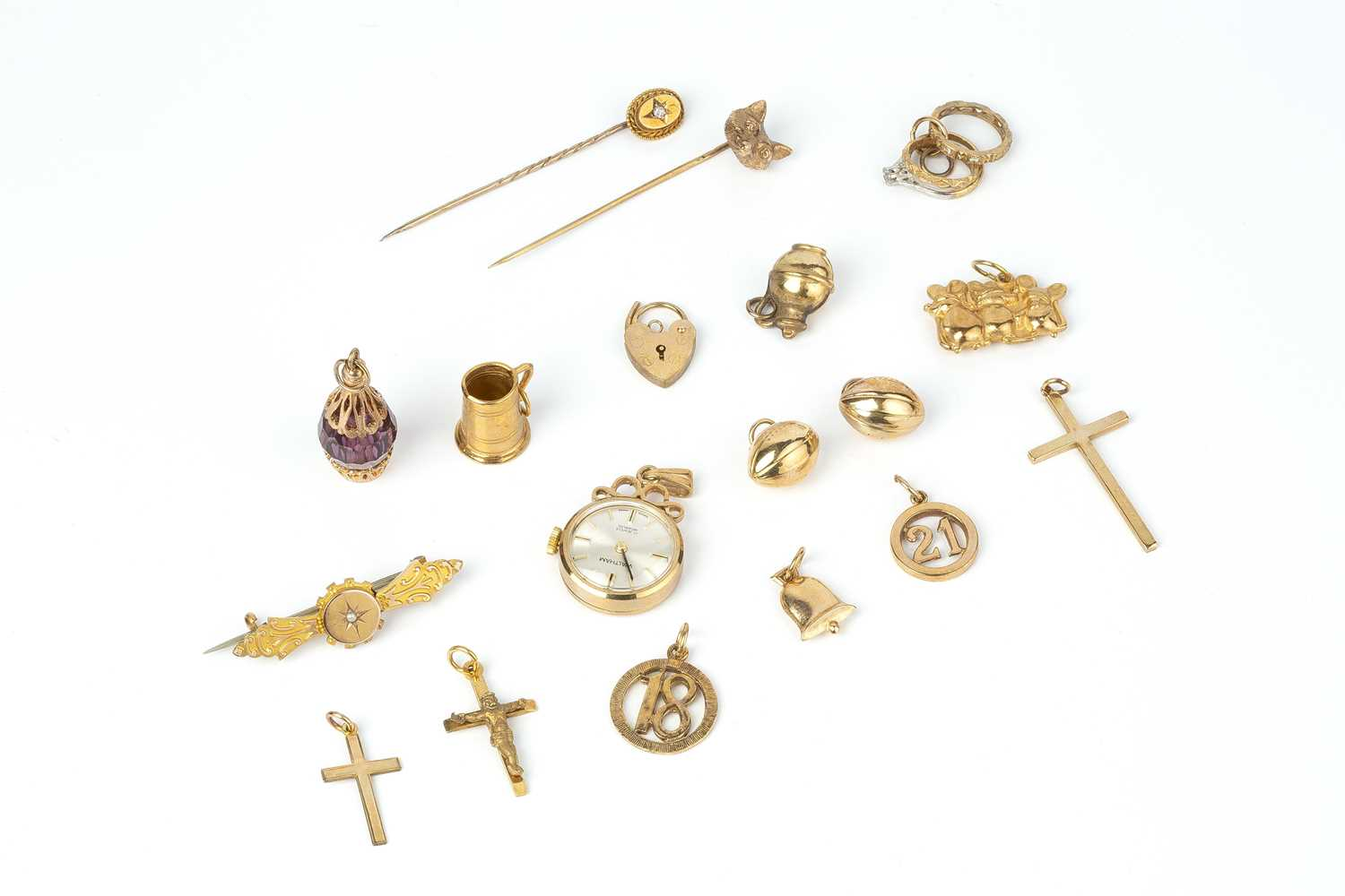 A collection of jewellery, comprising a diamond set stick pin, stamped '15ct', a 9ct gold stick pin,